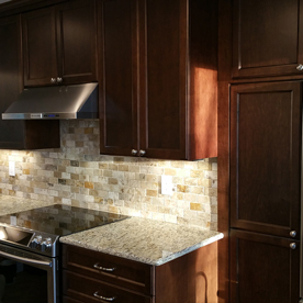 Dark wood kitchen with stone backsplash