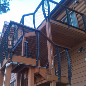 Exterior Staircase with Iron Railings